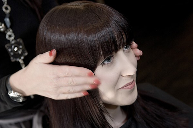 Image of dark haired  young woman after hair styling at The Salon in Hull. Unisex Hairdressor. Mens hairdresser, women's hairdresser. Children's hairdresser in Hull.